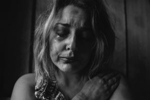 anxious, sressed, depressed woman crying because of her mental health condition
